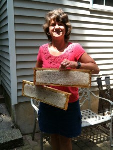 Mieke shows off a couple of frames of beautiful comb honey about to be cut.